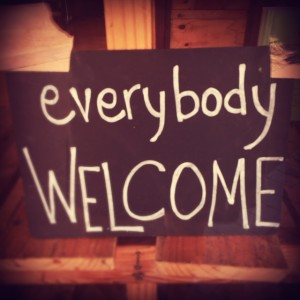 """Everybody welcome"" sign"